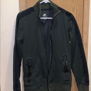Olive green Nike jacket.